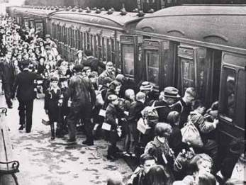 Children and families leaving by train