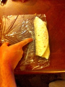 STEP 8 - Fold the right part of the food wrap over the burrito
