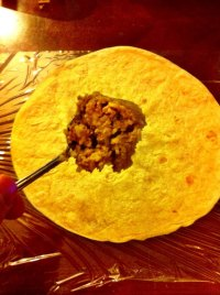STEP 2 - Get a couple of spoon-fulls of burrito filling and place it on the tortilla