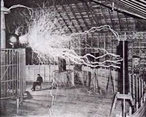 Tesla with his magnifying transmitter producing millions of volts of electricity