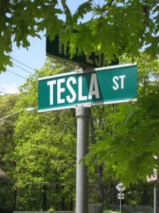 A street sign bearing Tesla's name near his former lab on Long Island, NY.  Although the lab buildings are still standing, it has been vacant for many years